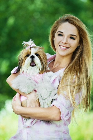 beautiful young woman standing summer park holds dog her arms Stock Photo - 10653950