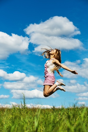 young beautiful young woman long hair high jumps photo