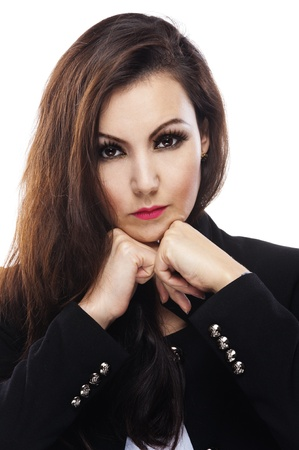 strict: beautiful strict woman with dark hair black jacket sitting leaning hands