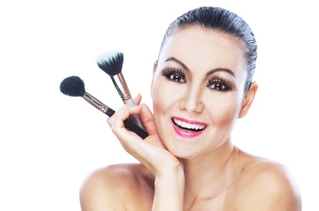 nude beautiful bright attractive woman smiling holding makeup brush photo