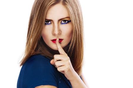 finger to lips: beautiful single woman wavy long hair white background holding finger near lips