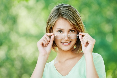 pretty attractive woman short hair wearing glasses walking park Stock Photo - 10672635
