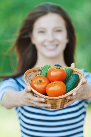 comestible: beautiful woman long hair blurred offers basket vegetables