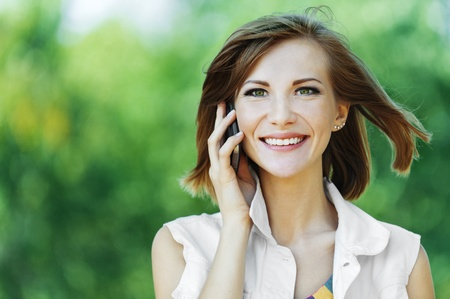 portrait pretty woman short hair phone smile Stock Photo - 10744321