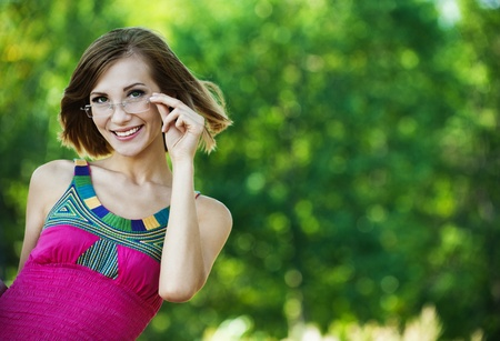 attractive woman pink dress glasses summer park Stock Photo - 10744328