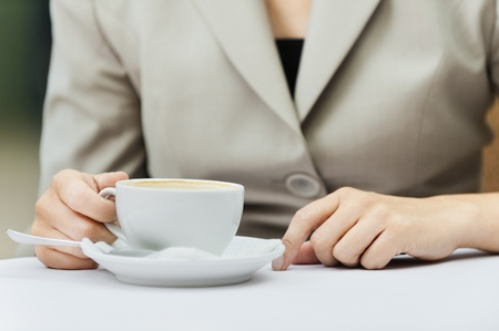 womans hand table cup saucer photo