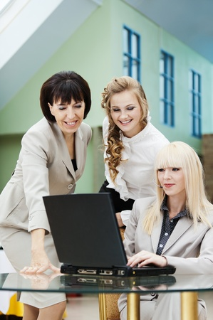 three business woman employee laptop table Stock Photo - 10829402