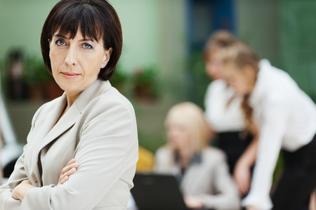 business woman stands behind collective laptop work photo