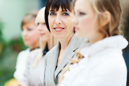 woman brunette smiling office colleagues photo