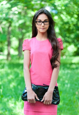 portrait girl glasses pink dress bag hand Stock Photo - 10829448