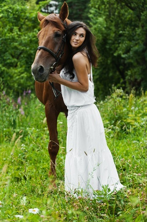 portrait attractive woman full length next horse photo