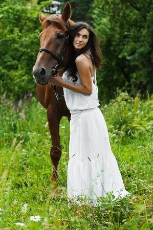 saddle: portrait attractive woman full length next horse
