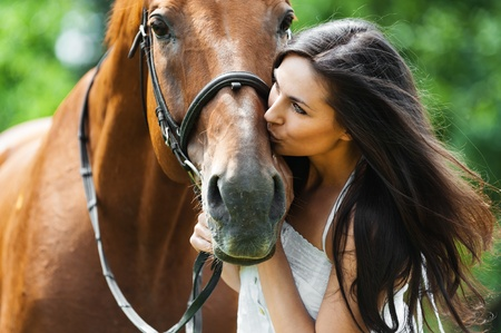 woman and horse: woman long hair kissing beautiful horse Stock Photo
