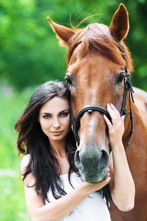 portrait beautiful woman long hair next horse Stock Photo - 11032780
