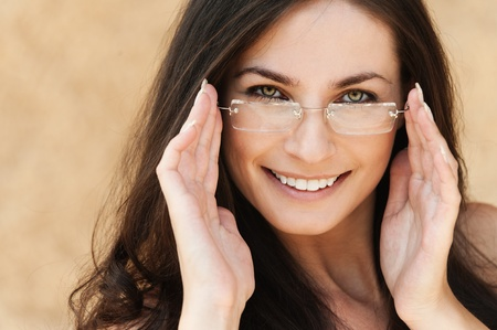sexy brunette beautiful woman with long hair wearing glasses Stock Photo - 11032770