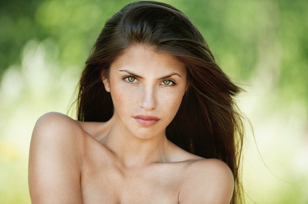 portrait young charming woman romantic sexy stripped serious background summer green park Stock Photo