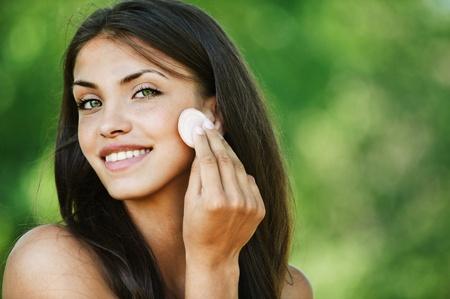 portrait naked beautiful woman brunette smiling powder background summer green park