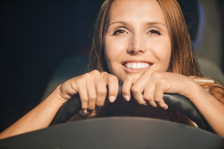 portrait beautiful young hands wheel smiling photo