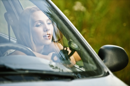 leaned: portrait young thoughtful beautiful woman sitting car leaned open window dreams background summer green nature Stock Photo
