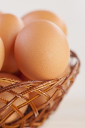 closeup wicker basket brown chicken eggs background isolation Stock Photo - 11254414
