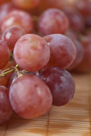 closeup red large bunch grapes background wooden table Stock Photo - 11254353