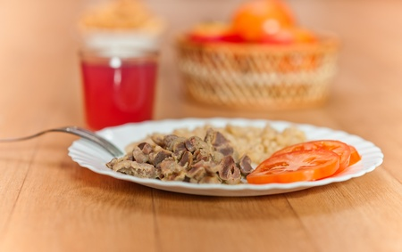pasta, braised meat, sliced tomatoes, glass juice, apples vase background wooden table photo