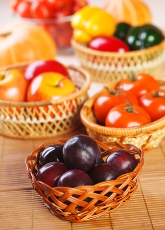 vegetables, fruits plums, apples, pumpkins, peppers, tomatoes background wooden table photo
