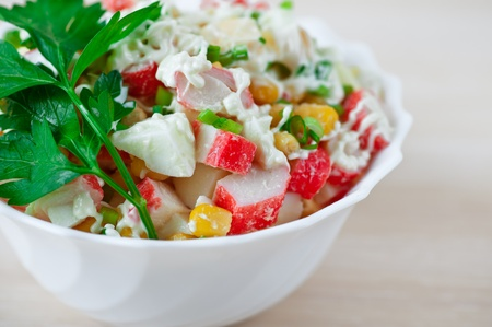 closeup crab salad with parsley decorated background table Stock Photo