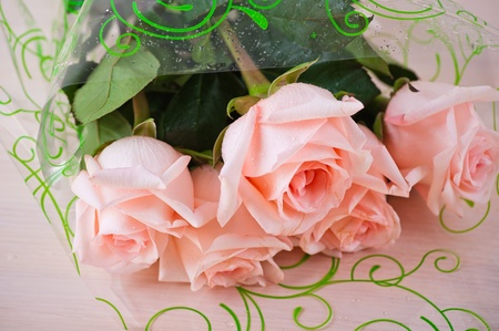 bouquet five pink roses background table photo