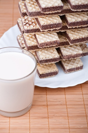 chocolate wafers, glass milk background wooden table Stock Photo - 11254855