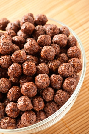 closeup crunchy dessert chocolate balls in bowl on background wooden table Stock Photo - 11256649