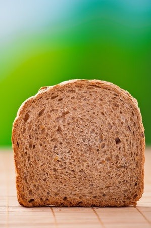 outdoors one cut rye bread, closeup on background wooden table Stock Photo - 11256648
