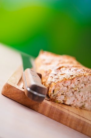 closeup meatloaf (beef, pork,veal) on cutting board,background outdoors,wooden table Stock Photo - 11256602