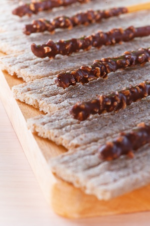bread with candied roasted nuts laid out for them in chocolate, all on wooden cutting board Stock Photo - 11480580