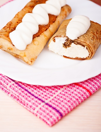 close-up delicious pancakes with cottage cheese and sour cream raisin is decorated on the background of the table with a napkin Stock Photo - 11480512