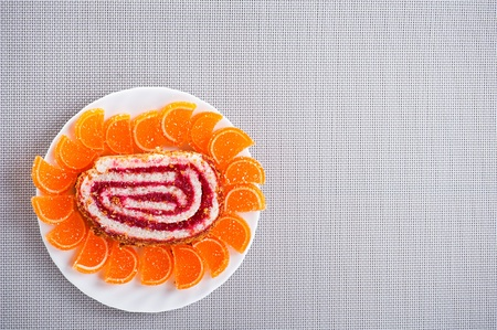 Tasty, colorful dessert: sweet rolls, orange marmalade on plate background table with tablecloth photo