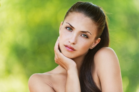 portrait of long-haired, beautiful, naked women standing shoulder lifting background summer green park Stock Photo - 11743173