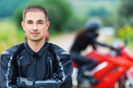 young handsome guy background woman overalls red motorcycle helmet photo