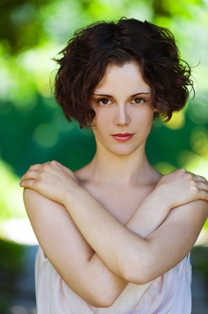 outside portrait of young beautiful brunette woman with fresh and clean skin photo