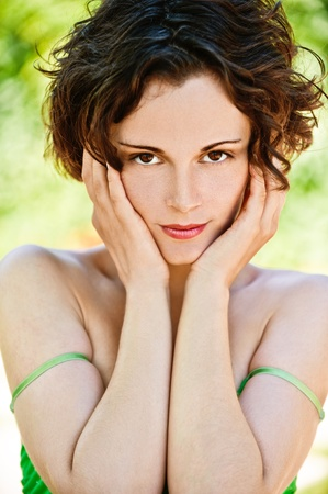 frenchwoman: outside portrait of young beautiful brunette woman with fresh and clean skin