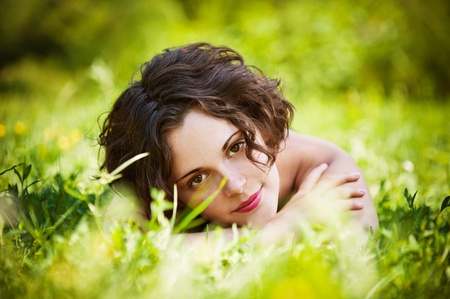 frenchwoman: Beautiful girl lies on lawn. Stock Photo