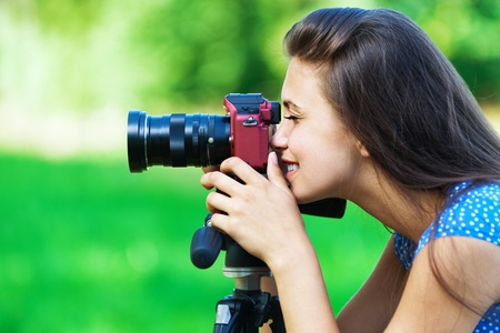 snapshot: portrait young charming woman camera smiling background summer green park