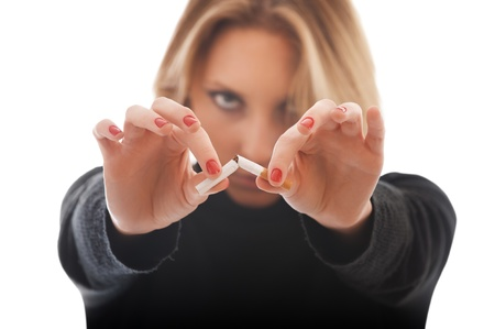 anti tobacco: young woman breaking cigarette isolated on white background
