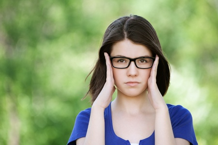 Portrait of young beautiful brunette woman wearing glasses at summer green park Stock Photo - 12472808