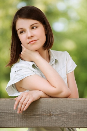 Portrait of young charming sad brunette woman at summer green park Stock Photo - 12473092