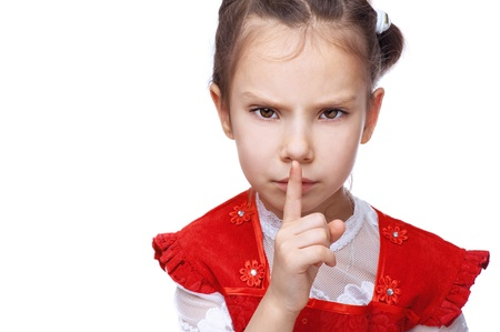 hand over: Little girl put her finger to her lips as sign of peace, isolated on white background.