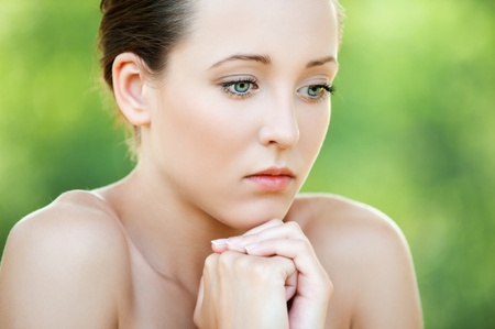 Portrait of pretty pensive young woman at summer green park Stock Photo - 13004361