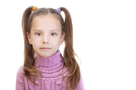 Little girl in pink sweater and with tails, isolated on white background. photo
