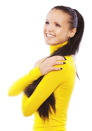 Portrait of smiling young beautiful woman in yellow turtleneck with beautiful manicure, isolated on white background. photo