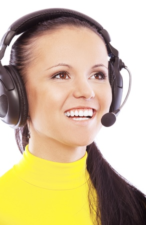 Portrait of smiling young beautiful woman in yellow turtleneck with headphones and microphone, isolated on white background. photo